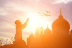 Silhouette muslim boy praying faith in allah God of islam suprem Stock Images