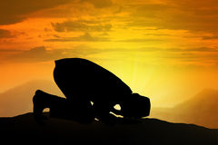 Silhouette Of Muslim Man Praying Stock Photos