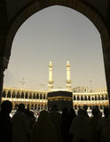 Silhouette of Muslim pilgrims and the Kaabah Royalty Free Stock Photography