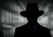 Silhouette of a mysterious man in a hat Royalty Free Stock Photo