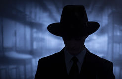 Silhouette of a mysterious man in a hat. Silhouette of a mysterious man in a vintage style wide brimmed hat in a close up head and shoulders portrait Stock Photography
