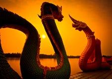 Silhouette Naga statues Stock Image