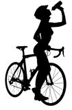 Silhouette of a naked woman with a bicycle Royalty Free Stock Image