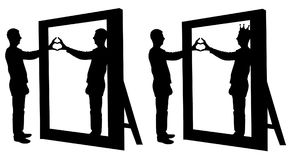 Silhouette  of a narcissist man and a hand gesture of a heart in reflection in a mirror. The concept of narcissism and selfishness Royalty Free Stock Images