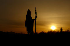 Silhouette of native american shaman with pikestaff on backgroun Royalty Free Stock Photography