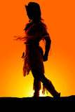 Silhouette of Native American woman leg back dress blowing Stock Photo