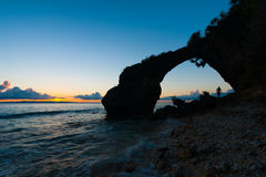 Silhouette Natural Bridge Sunset Rocky Beach Stock Photography