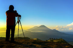 Silhouette nature photographer in action during sunrise Royalty Free Stock Image