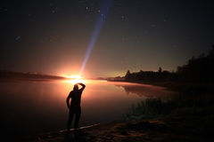 Silhouette near lake at starry night Stock Image