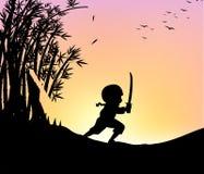 Silhouette ninja cutting bamboo with sword Stock Photos