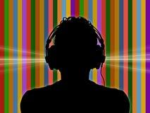 Le DJ dans des écouteurs sur un fond génial Photographie stock libre de droits