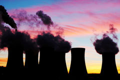 Silhouette of nuclear power plant during sunset Stock Photos
