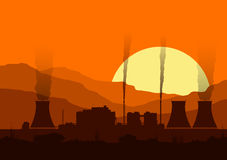 Silhouette of a nuclear power plant at sunset. Royalty Free Stock Image