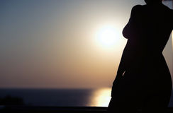 Silhouette of nude girl on sunset background. Silhouette of nude girl on sunset Royalty Free Stock Images