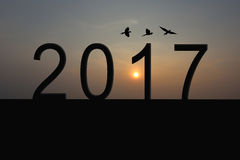 Silhouette of number 2017 on the house roof and sunrise in twili Royalty Free Stock Images