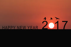 Silhouette of number 2017 on the house roof and sunset in twilig Stock Images