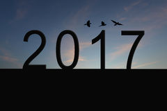 Silhouette of number 2017 on the house roof and sunset in twilig Royalty Free Stock Photo