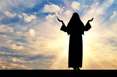 Silhouette of nuns against the evening sky Stock Image