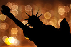 Silhouette NY Statue of Liberty. Against light circle as fireworks or night city Royalty Free Stock Photo