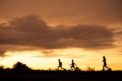 Free Silhouette Of A Boy Playing On The Sunset Background Royalty Free Stock Photography - 103099717