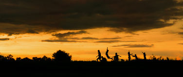 Free Silhouette Of A Boy Playing On The Sunset Background Stock Photography - 99230592