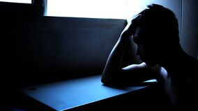Free Silhouette Of A Depressed Man In A Dark Room. Mental Health, Depression And Feeling Blue Concept Royalty Free Stock Photo - 171534615