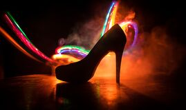 Free Silhouette Of A High Heel Women Shoes At Dark. Women Power Or Women Domination Concept Stock Photography - 194576042