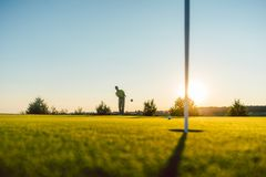 Free Silhouette Of A Male Player Hitting A Long Shot On The Putting G Stock Image - 101126081