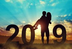 Free Silhouette Of A Man Holding A Woman In His Arms.New Year 2019 Concept. Stock Images - 133751994