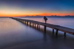 Free Silhouette Of A Photographer On Pier, Alcudia Royalty Free Stock Image - 170015706