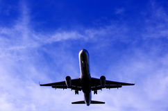 Silhouette Of A Plane In The Sky Royalty Free Stock Photos