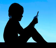 Free Silhouette Of A Reading Boy Stock Image - 19543921