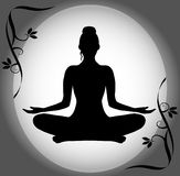 Silhouette Of A Woman In The Lotus Position Stock Photo