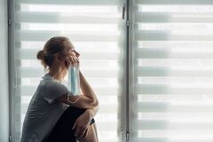 Free Silhouette Of Alone Woman Sitting On The Windowsill On The Background Of Window. Quarantine, Self-isolation, Stay At Home. Concept Royalty Free Stock Photos - 179095568