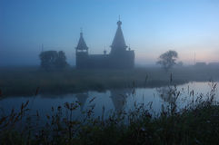 Silhouette Of Ancient Wooden Church At Sunrise Royalty Free Stock Images