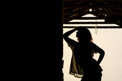 Silhouette Of Beautiful Girl Outdoor In Old Warehouse Royalty Free Stock Images