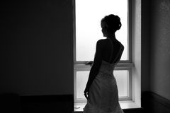 Silhouette Of Bride In Black & White Stock Photo