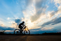 Free Silhouette Of Cyclist Motion On Sunset Background Stock Photography - 79979182