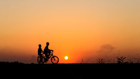 Free Silhouette Of Cyclist With Friend Motion On Sunset Background Stock Photos - 66604233
