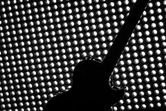 Free Silhouette Of Electric Guitar On Lighting Grid Royalty Free Stock Photo - 66362985