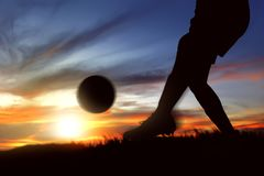 Silhouette Of Football Player Woman Kicking The Ball On The Grass Field Royalty Free Stock Image