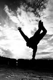 Silhouette Of Girl Doing A One Arm Handstand Stock Photos