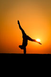 Silhouette Of Gymnast At Beach Stock Image
