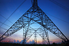 Silhouette Of High Voltage Electric Pole Against Beautiful Dusky Royalty Free Stock Images
