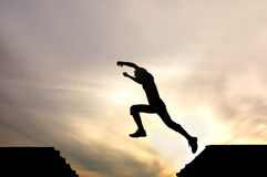 Silhouette Of Jumping Man Royalty Free Stock Photography