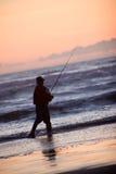 Silhouette Of Man Fishing Stock Image