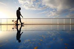 Silhouette Of Old Man Walking Throught Deck Stock Photography