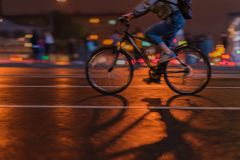 Free Silhouette Of Riding Cyclists On The City Roadway, Night, Abstract, Motion Blur Stock Image - 111639501