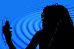 Silhouette Of Teen With Digital Video Player Royalty Free Stock Photos