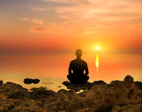 Silhouette Of The Meditating Royalty Free Stock Photos
